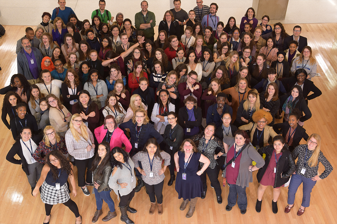 Attendees posing for a large group photo at the APS women conference