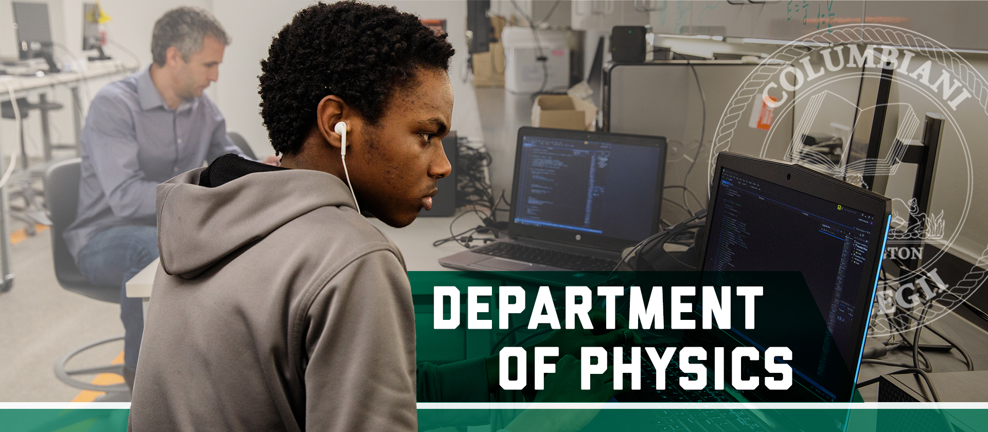 a black CCAS undergraduate physics student researching on a laptop. Department of Physics, Columbian College seal
