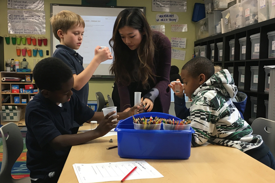 undergraduate Soyeon Park teaches fourth graders at Maury Elementary in D.C