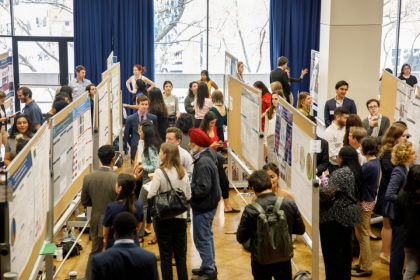 GW students standing with their research posters at Research Days 2019